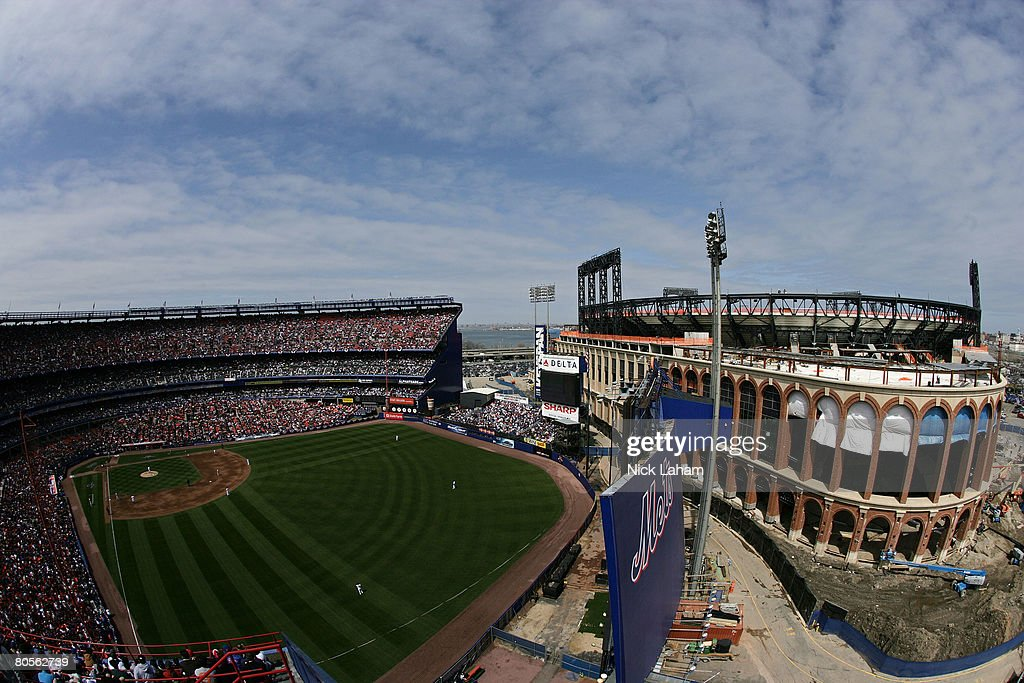 The Philadelphia Phillies take on the New York Mets during the last home opener at Shea Stadium on April 8, 2008 in the Flushing neighborhood of the Queens borough of New York City. The Mets new stadium, Citi Field, is seen in the backround.