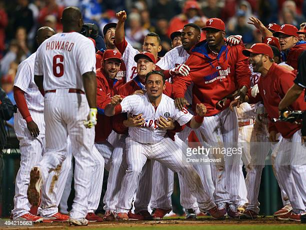 The Philadelphia Phillies wait at home plate for Ryan Howard after he hit a walk-off three-run home run in the ninth inning against the Colorado...