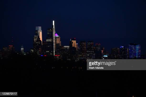 The Philadelphia skyline is seen at dusk seven days after the general election, where votes are still being counted in the convention center on...