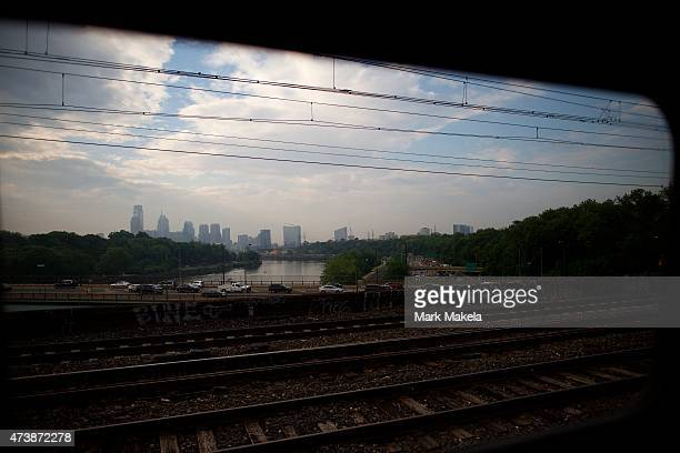 The Philadelphia skyline is seen from a Amtrak train which resumed service from 30th Street Station with a 553am departing train after last week's...