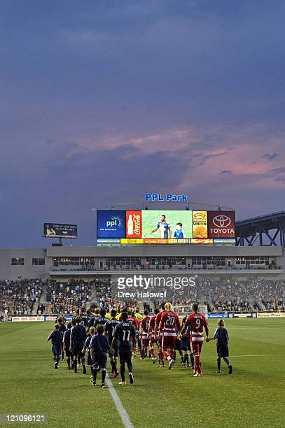 The Philadelphia Union and FC Dallas walk onto the field before the game at PPL Park on August 13 2011 in Chester Pennsylvania The game ended 22