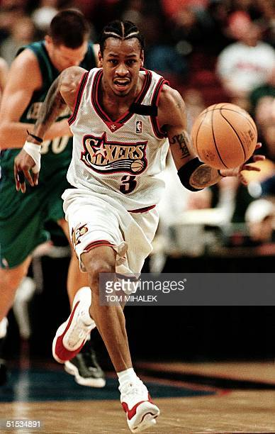 The Philadlephia 76ers' Allen Iverson runs towards the basket against the Charlotte Hornets 11 December 1999 in Philadelphia Iverson returned to...