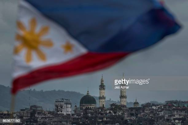 The Philippine flag is seen waving over the besieged city of Marawi on October 20 2017 in Marawi southern Philippines President Rodrigo Duterte...