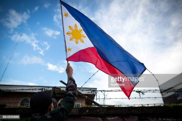 The Philippine National Police hang flags in wartorn Marawi City in preparation for the celebration of Independence Day on June 12 Lanao del Sur...