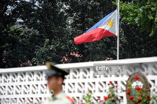 The Philippines' flag flies at half mast at the embassy in Beijing on August 25 2010 two days after eight Hong Kong tourists were killed in Manila...