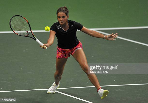 The Philippines' Katharina Lehnert returns to India's Ankita Raina in the Fed CupOceana Group II Tennis Championship final at Fateh Maidan Tennis...
