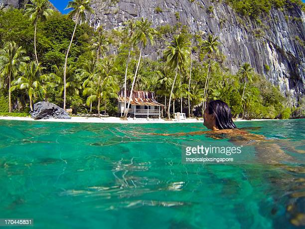 The Philippines, Palawan Province, El Nido, swimming in tropical waters.