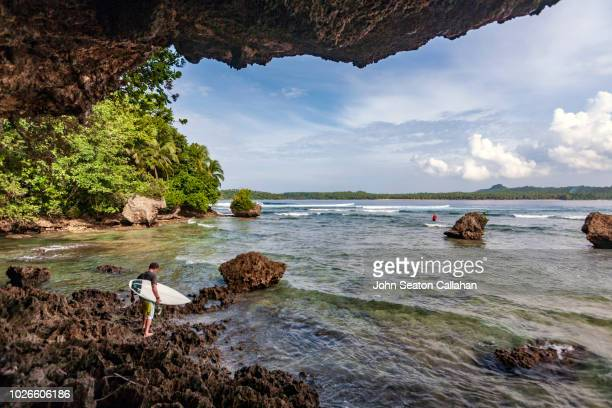 the philippines, surfers in eastern samar - tacloban stock pictures, royalty-free photos & images