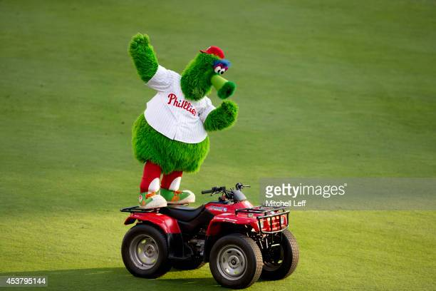 The Phillie Phanatic dances on his ATV prior to the game between the Seattle Mariners and Philadelphia Phillies on August 18 2014 at Citizens Bank...