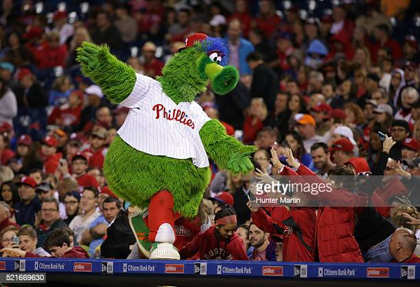 The Phillie Phanatic entertains some fans in the seventh inning during a game between the Philadelphia Phillies and the Washington Nationals at...