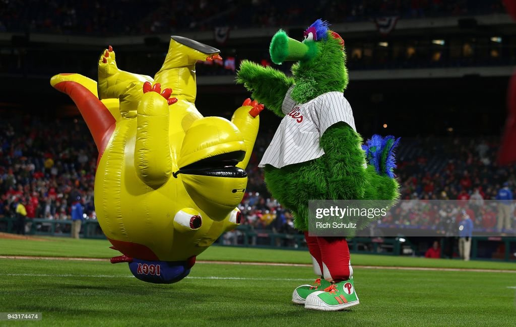 The Phillie Phanatic entertains with a member of the Galapagos Gang during a game between the Miami Marlins and Philadelphia Phillies at Citizens Bank Park on April 7, 2018 in Philadelphia, Pennsylvania. The Phillies defeated the Marlins 20-1.