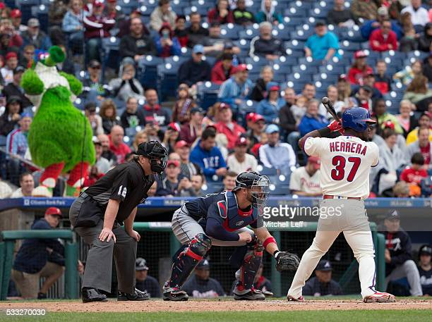 The Phillie Phanatic flashes the pitcher during the at bat of Odubel Herrera of the Philadelphia Phillies in the bottom of the third inning against...