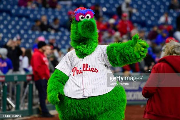 The Phillie Phanatic greets patrons before the game at Citizens Bank Park on April 15, 2019 in Philadelphia, Pennsylvania. All players are wearing...