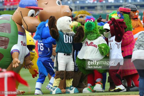 The Phillie Phanatic is surrounded by local mascots to celebrate its 41st birthday before a game against the Miami Marlins at Citizens Bank Park on...