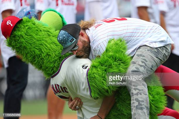 The Phillie Phanatic is tackled by former Phillies player Jayson Werth during a pre-game ceremony celebrating the 2009 Nation League Champion...