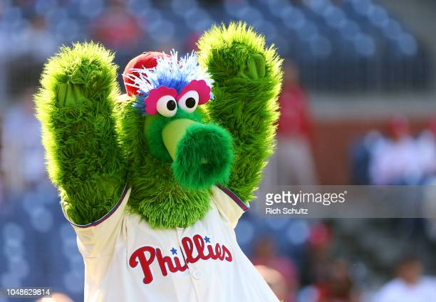 The Phillie Phanatic performs before a game between the Atlanta Braves and the Philadelphia Phillies at Citizens Bank Park on September 30 2018 in...