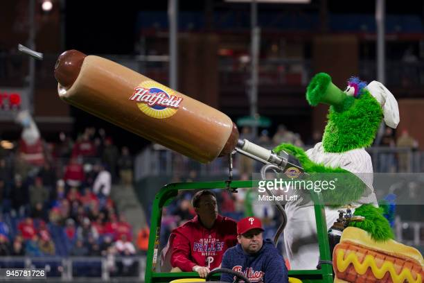 The Phillie Phanatic shoots hot dogs at the end of the fifth inning against the Cincinnati Reds at Citizens Bank Park on April 10 2018 in...