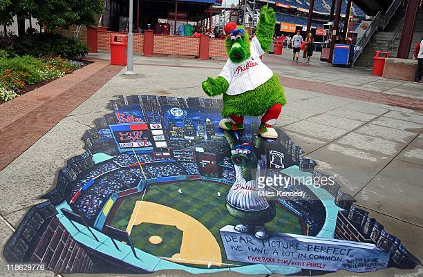 The Phillie Phanatic stands the new With Love 3D Art attraction at Citizens Bank Park before the Philadelphia Phillies game against the Atlanta...