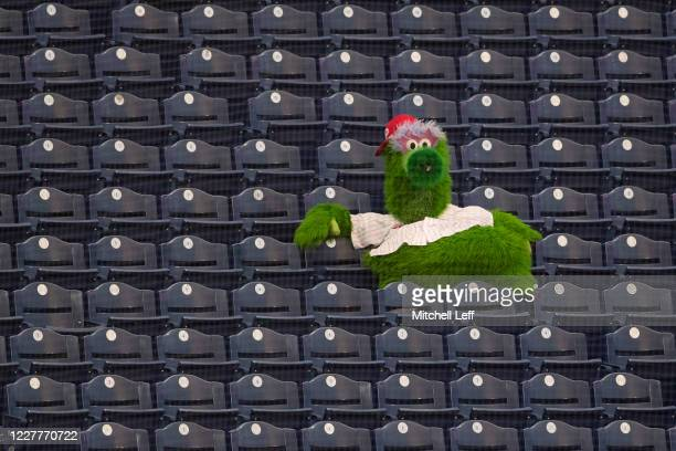The Phillie Phanatic watches the game between the Miami Marlins and Philadelphia Phillies from the stands in the bottom of the third inning during...