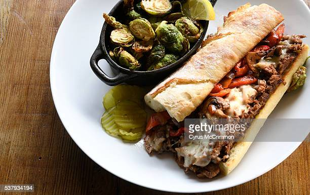 The Philly cheesesteak sandwich with Brussel sprouts at The Rosedale a new restaurant at 1135 E Evans on Thursday June 2 2016