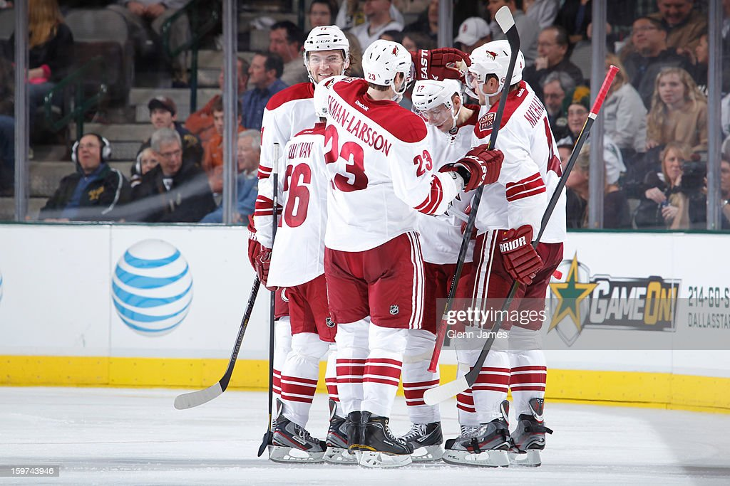 The Phoenix Coyotes celebrate a goal against the Dallas Stars at the American Airlines Center on January 19, 2013 in Dallas, Texas.