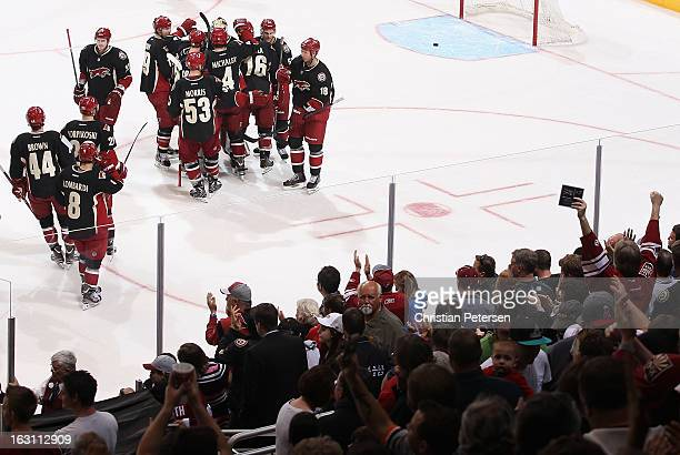 The Phoenix Coyotes celebrate around goaltender Mike Smith after defeating the Anaheim Ducks 54 in an overtime shootout following the NHL game at...