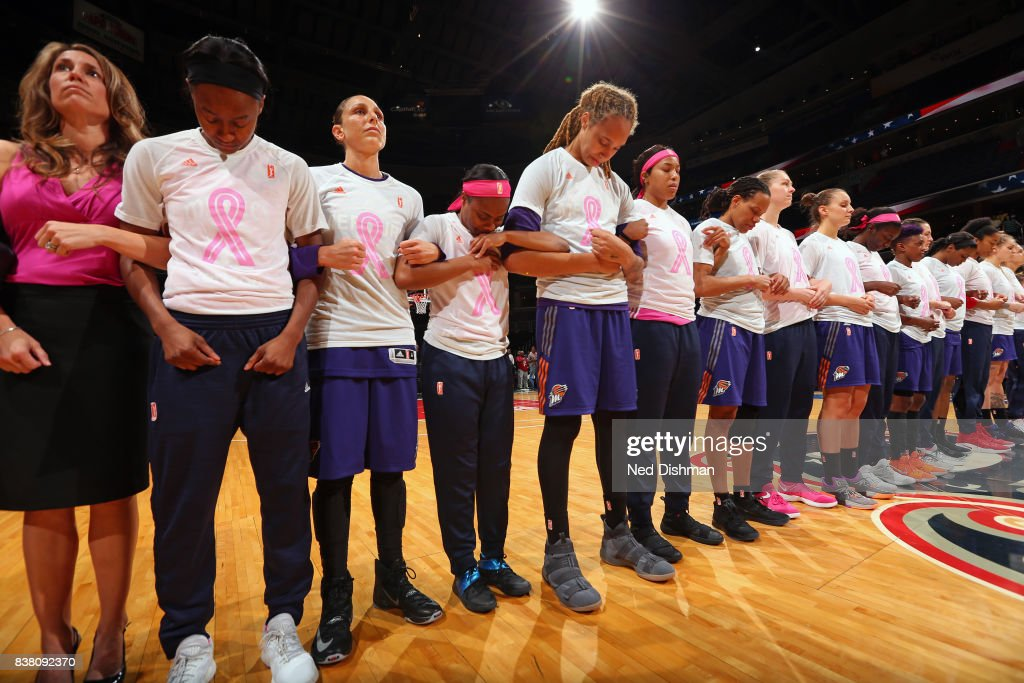 The Phoenix Mercury and the Washington Mystics stand for a moment of silence for the National Anthem before the game on August 18, 2017 at the Verizon Center in Washington, DC.