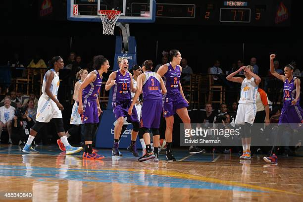 The Phoenix Mercury celebrate after Diana Taurasi hit the game winning shot against the Chicago Sky in Game Three of the 2014 WNBA Finals on...