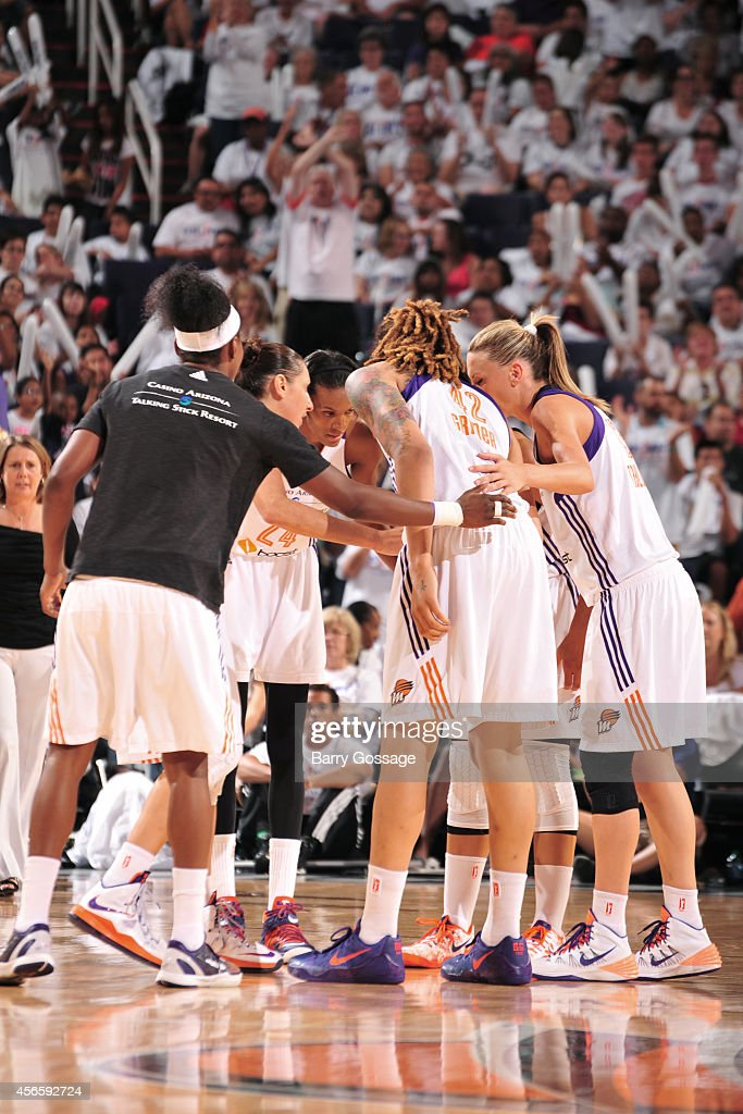 The Phoenix Mercury huddle during a game against the Minnesota Lynx in Game 1 of the 2014 WNBA Western Conference Finals on August 29, 2014 at US Airways Center in Phoenix, Arizona.