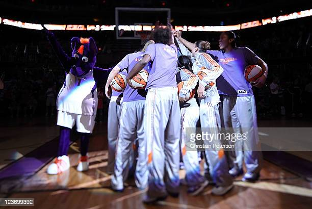 The Phoenix Mercury huddle up as they are introduced to the WNBA game against the Los Angeles Sparks at US Airways Center on September 3 2011 in...
