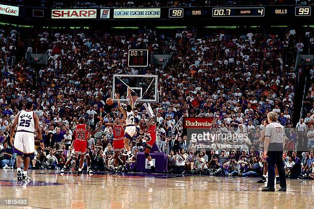 The Phoenix Suns attempt a last second game winning shot during Game Six of the 1993 NBA Championship Finals at America West Arena on June 20 1993 in...