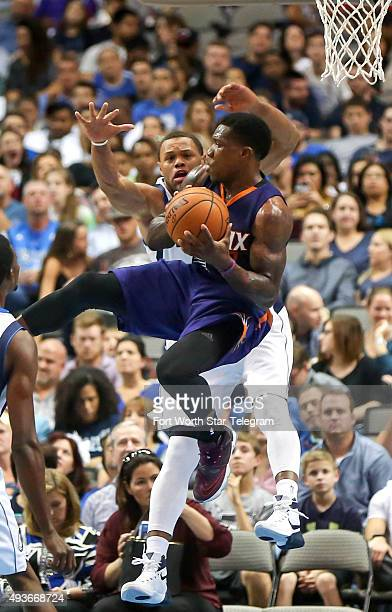 The Phoenix Suns' Eric Bledsoe drives against the Dallas Mavericks' Justin Anderson during the first quarter of a preseason game on Wednesday, Oct....
