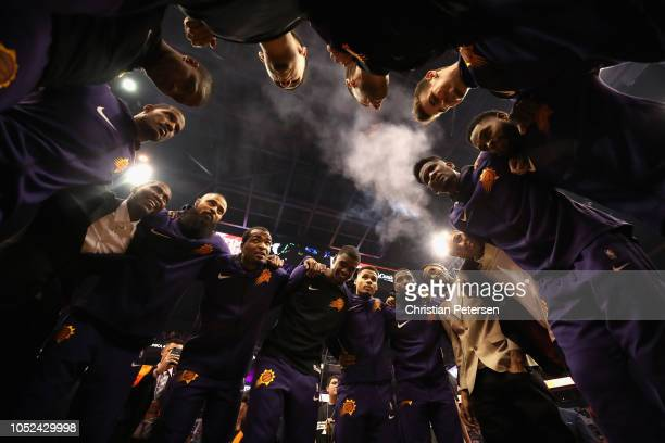 The Phoenix Suns huddle up before the NBA game against the Dallas Mavericks at Talking Stick Resort Arena on October 17 2018 in Phoenix Arizona NOTE...