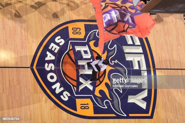 The Phoenix Suns mascot waves the team flag before the game against the Portland Trail Blazers on October 18 2017 at Talking Stick Resort Arena in...