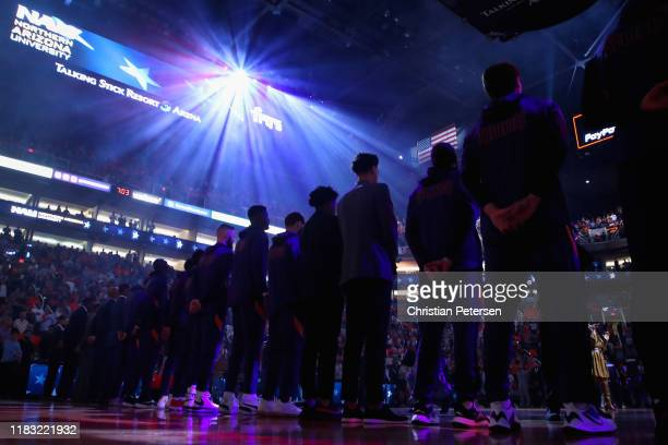 The Phoenix Suns stand attended for the national anthem before NBA game against the Sacramento Kings at Talking Stick Resort Arena on October 23 2019...