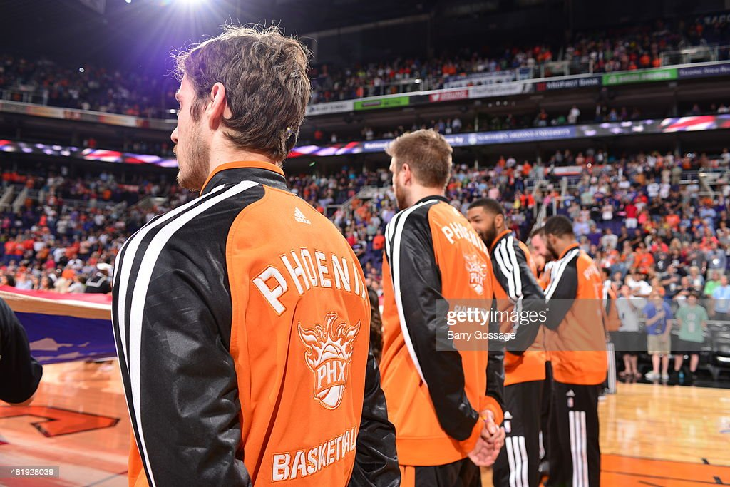 The Phoenix Suns stand during the National Anthem before the game against the New York Knicks on March 28, 2014 at U.S. Airways Center in Phoenix, Arizona.