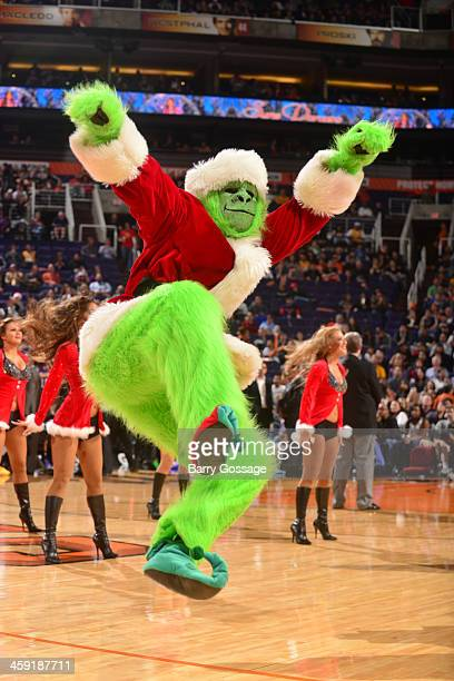 The Phoenix Suns's Gorilla green to match the Grinch dances during a timeout as the Suns host the Los Angeles Lakers on December 23 2013 at US...