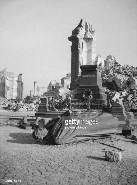The photo by famous photographer Richard Peter sen shows the destroyed Luther memorial in front of the ruins of the Dresden Frauenkirche in Dresden...