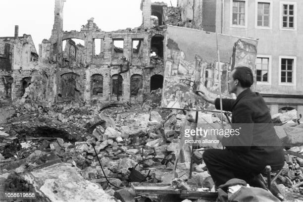 The photo by famous photographer Richard Peter sen shows the painter Theodor Rosenhauer in the midst of ruins in Dresden working on his oil painting...