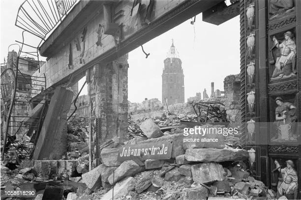The photo by famous photographer Richard Peter sen shows the ruins of the Mohrenapotheke in the Johannesstraße in Dresden The photo was taken after...