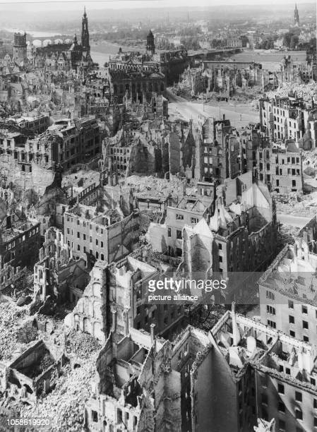 The photo by famous photographer Richard Peter sen shows the view from the Town Hall tower overlooking the destroyed city of Dresden towards the...