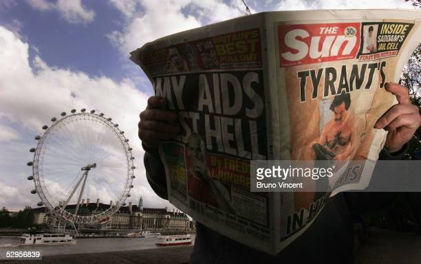 The photo illustration shows a man reading a copy of The Sun newspaper with an image of former President Saddam Hussein in his underwear May 20 2005...
