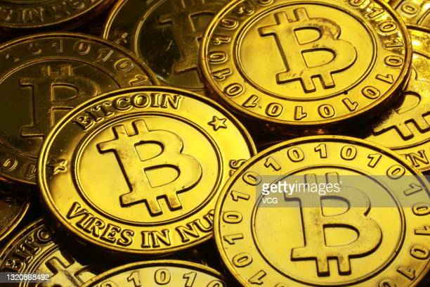 The photo illustration shows the Bitcoin cryptocurrency on May 30, 2021 in Beijing, China.