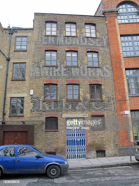 CONTENT] The photo shows a faded painted advert on the bricks of a former wire works factory Tanner Street