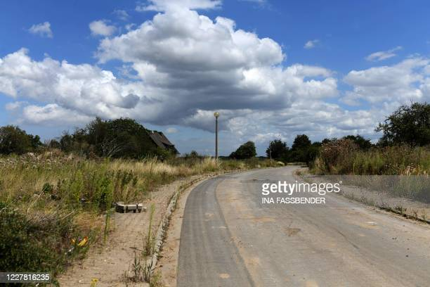 The photo shows an empty street in Manheim, near the Hambacher lignite mining in western Germany, on July 28, 2020. - In 2012 the first residents...