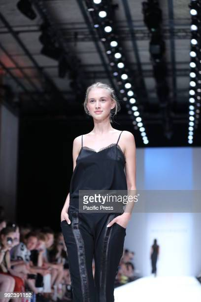 The photo shows models on the catwalk with the collection spring/summer 2019 of the designer Maisonnée.