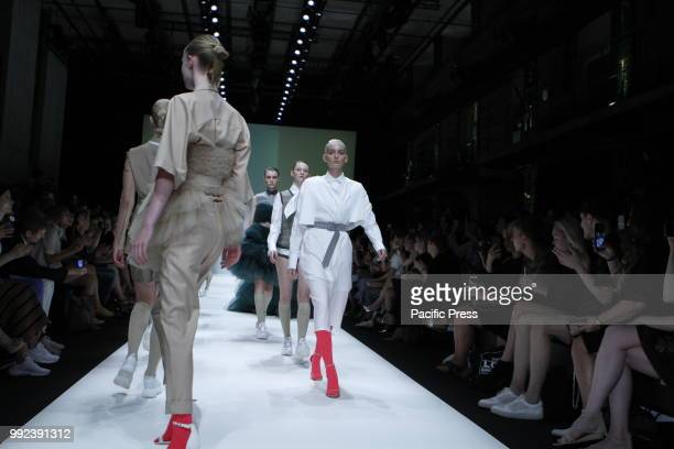The photo shows models on the catwalk with the collection spring/summer 2019 of the designer Danny Reinke.