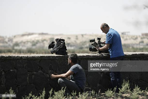 The photo taken from Karkamis district of southeastern province Gaziantep Turkey shows that press members take photos behind the shield during the...