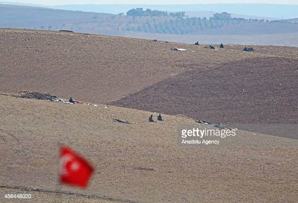 The photo taken from Turkey's border town Suruc shows that the ISIL militants fight against the Kurdish armed groups on October 1 2014 in Zorafa...