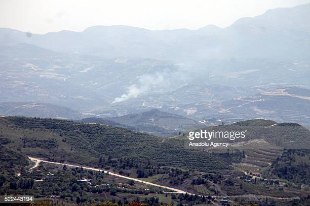 The photo taken from Turkey's Hatay shows that smoke rises after the Assad regime forces bombed the Turkmendagi and Cebel Ekrad region in Lattakia...